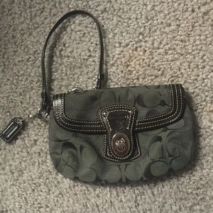 Olive green Coach wristlet with zipper pocket